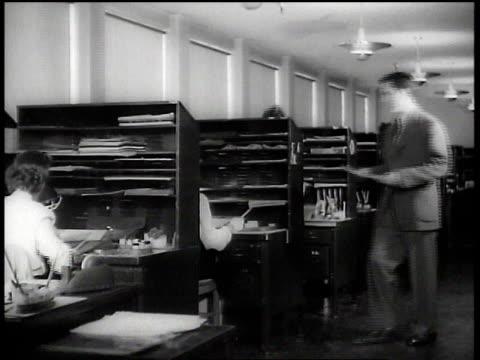 vídeos de stock, filmes e b-roll de 1943 ws artists working in ink & paint department at walt disney animation studios / hollywood, california, united states - walt disney animation studios