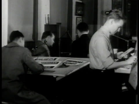 Artists working on Boy Scouts advertisements MS Artist working on poster 'America's Answer' MS Men checking designs of posters CU Picture of Boy...