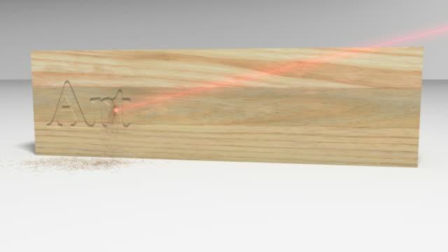 vídeos de stock, filmes e b-roll de arts and crafts carved on a block of wood by laser - escrita ocidental
