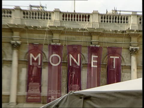 london monet exhibition lib england london royal academy long queue of people outside academy pan and zoom in to banners spelling out 'monet' on wall... - royal academy of arts stock videos & royalty-free footage