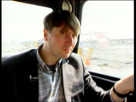 millennium poet in residence itn england london greenwich simon armitage sitting in car gv millennium dome construction site seen through car window... - poet stock videos & royalty-free footage