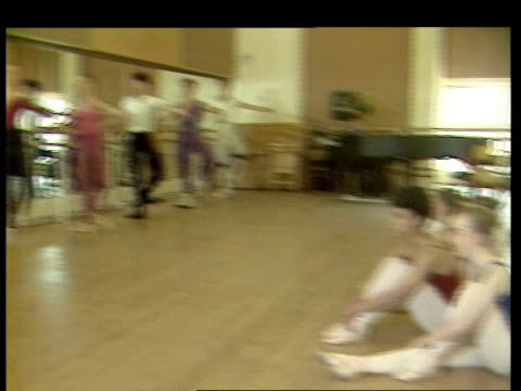 young ballet hopefuls england london young girl looking at poster pan up to poster for bolshoi ballet ms girl outside looking at poster ms young... - ballet dancing stock videos & royalty-free footage