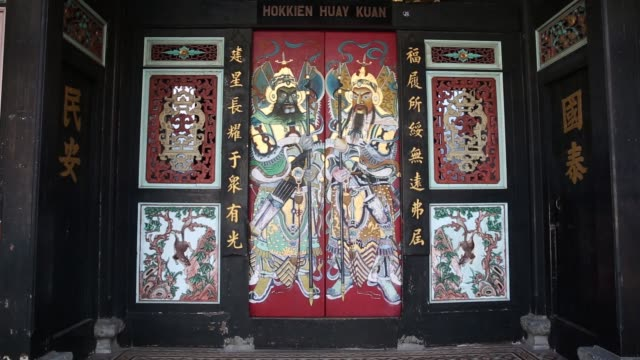 artwork adorns a chinese temple in the chinatown area of malacca city malaysia on friday july 28 pedestrians walk past shophouse stores on jonker... - malacca stock videos and b-roll footage