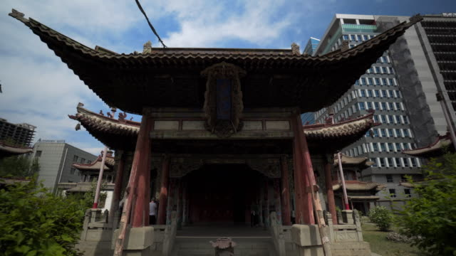 artwork at entrance of choijin lama temple against buildings in city  - ulaanbaatar, mongolia - monastery stock videos & royalty-free footage