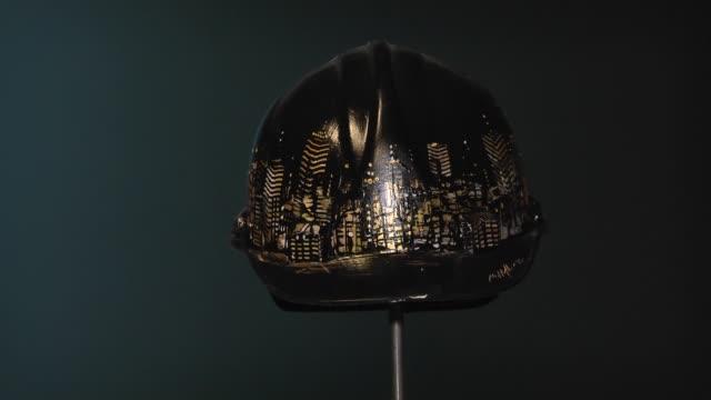 Artwork helmets are being displayed during 'Deus Ex Machina' exhibition owned by Mehmet Ali Ak and Sezer Ak at CerModern in Ankara Turkey on December...