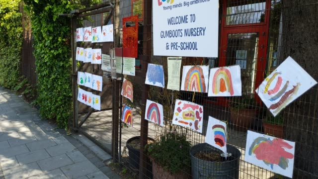 artwork on the fence outside gumboots nursery and pre-school during the coronavirus pandemic on april 15, 2020 in london, england. the pandemic has... - brian dayle coronavirus stock videos & royalty-free footage