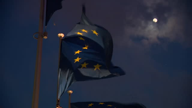 """arty exteriors of european commission building and eu flags, at night, brussels - """"bbc news"""" stock videos & royalty-free footage"""