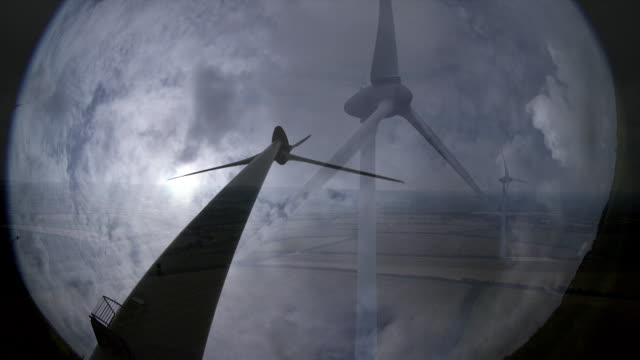arty low angle shot of wind turbine in silhouette against the clouds cornwall - turbine stock videos & royalty-free footage