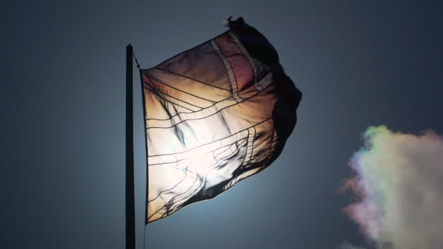 arty slomo union jack flag moving front of bright sun - flag stock videos & royalty-free footage
