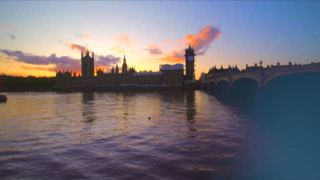 arty timelapse of parliament and city on thames - parliament building stock-videos und b-roll-filmmaterial