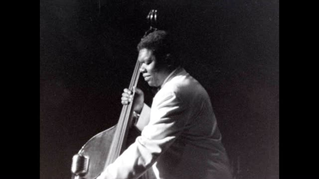 Arvell Shaw playing the Jazz bass for Louis Armstrong and band