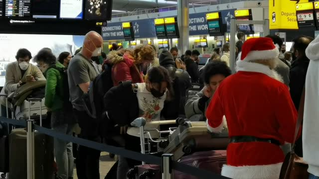 as a growing lists of world nations has barred travel from the uk to block a new strain of coronavirus, londoners continue to wait at the... - flughafen heathrow stock-videos und b-roll-filmmaterial