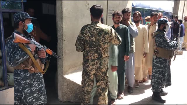 as afghanistan began a new era of taliban rule, huge lines were seen outside banks in kabul on thursday the taliban took full control of the airport... - bagram stock videos & royalty-free footage