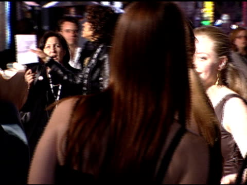 ZI as Amanda Seyfried and Daveigh Chase hug each other and then pose for paparazzi on red carpet