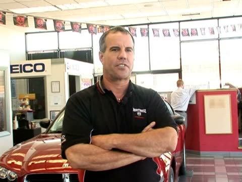 stockvideo's en b-roll-footage met as america's iconic car companies hit rough times the often familyowned car dealerships are taking a hit many like the dodge dealership in germantown... - chrysler