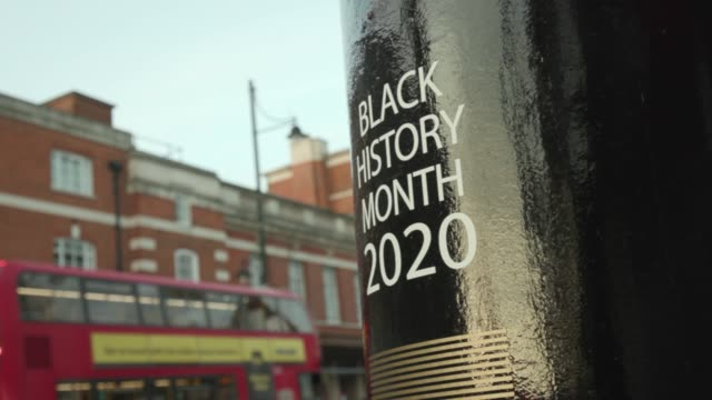 as black history month begins, royal mail unveils four special edition postboxes in each uk nation. the decorated postboxes honour black britons both... - ロイヤルメール点の映像素材/bロール