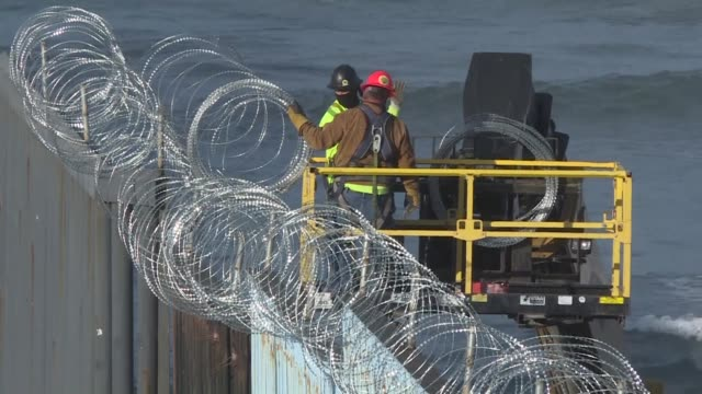 as central american migrants keep arriving in tijuana us border authorities continue to add barbed wire to the border fence fearing they might... - baja california norte stock videos & royalty-free footage