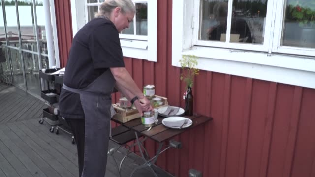 as chef malin soderstrom opened the can, the trapped air escaped with a hiss and filled the balcony of her waterside restaurant with the pungent... - infamous stock videos & royalty-free footage