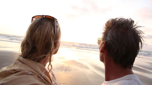 pov as couple look out to sea, from tidal flat - exploration stock videos & royalty-free footage