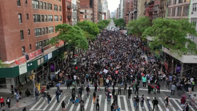 as demonstrations continue to rock the us thousands of new yorkers on tuesday staged a peaceful demonstration to call for an end to police violence... - george floyd stock videos & royalty-free footage