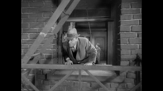 1931 as editor (adolph menjou) spikes his drink, reporter escapes out of rear window (pat o'brien) - 1931 stock videos & royalty-free footage