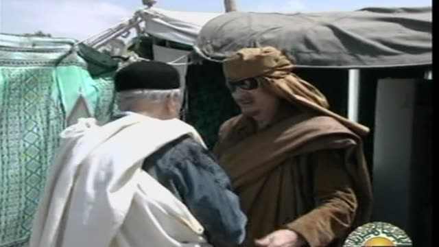 as fierce fighting continues elsewhere in libya the country's state television shows leader moamer kadhafi welcoming political visitors to his tent... - libyan civil war stock videos & royalty-free footage