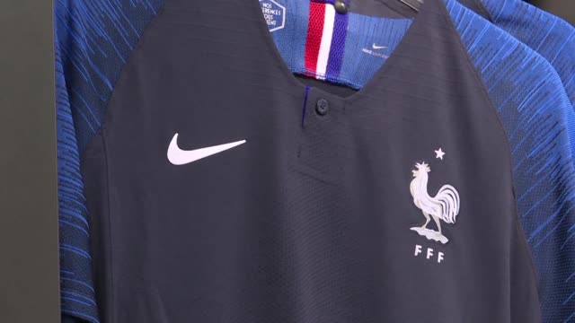 as france prepare to face belgium in the world cup semi-final french fans back home are flocking to buy the team's national football jersey with... - shirt stock videos & royalty-free footage