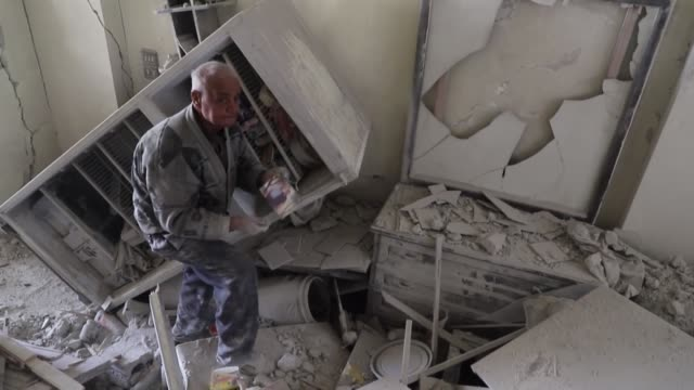 as he passes by the debris of his home, abu mazen, a 70-year-old syrian, recalls the 20 years he lived in the building in kafr batna town in the... - only girls stock videos & royalty-free footage