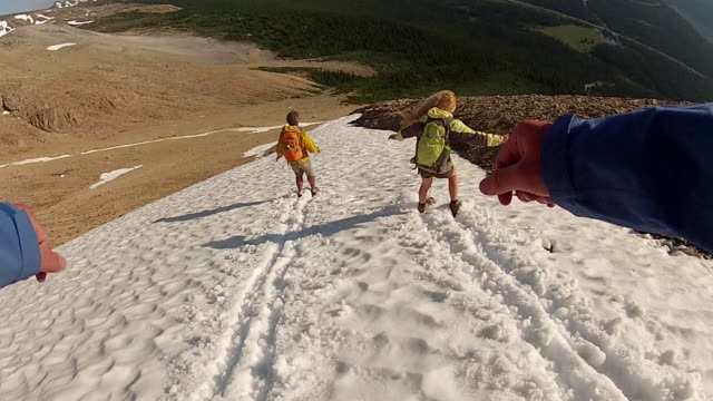 pov as hikers descend snow slope while boot skiing - boot stock videos & royalty-free footage