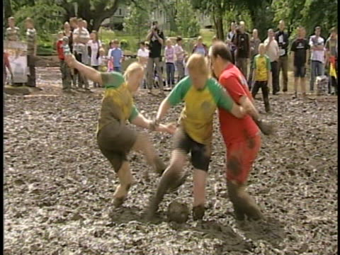 as if playing soccer wasn't hard enough, try doing it in a swamp with thick mud all around you! - all around competition stock videos & royalty-free footage