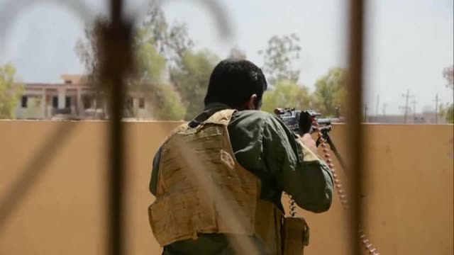 As Iraqi forces advance through Tal Afar their Shiite religious songs mix with the crackle of gunfire by Islamic State group jihadists and the boom...