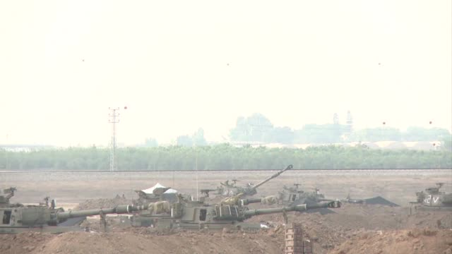 as israel continues its assault on the gaza strip on tuesday its artillery batteries pounded areas in the north and the center of the palestinian... - 2014 stock videos and b-roll footage