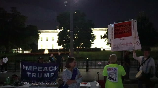 as lighting lights up the sky in the distance protesters participate in the nightly 'kremlin annex' rally against united states president donald... - lafayette square washington dc stock videos & royalty-free footage