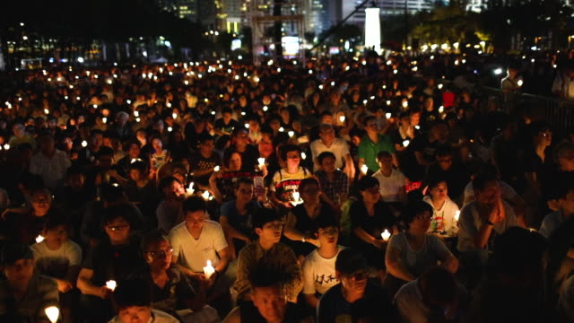 as many as 180,000 people are expected to attend a candlelight vigil in hong kong on tuesday during the 30th anniversary of the tiananmen square... - tiananmen square stock videos & royalty-free footage