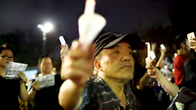 as many as 180,000 people are expected to attend a candlelight vigil in hong kong on tuesday during the 30th anniversary of the tiananmen square... - 30 seconds or greater stock-videos und b-roll-filmmaterial