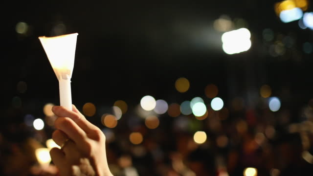 as many as 180,000 people are expected to attend a candlelight vigil in hong kong on tuesday during the 30th anniversary of the tiananmen square... - candlelight stock videos & royalty-free footage