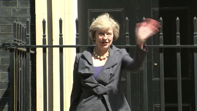 as one prime minister prepares to enter downing street another was packing up to leave today - after being praised by his colleagues as an... - entering stock videos & royalty-free footage