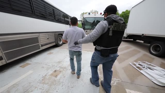 as part of an ongoing criminal investigation, special agents with u.s. immigration and customs enforcement's homeland security investigations... - detainee stock videos & royalty-free footage