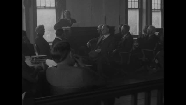 vídeos de stock, filmes e b-roll de as part of his jury charges to the grand jury in the john scopes evolution case judge john t raulston reads divine creation story from the bible in... - lawsuit