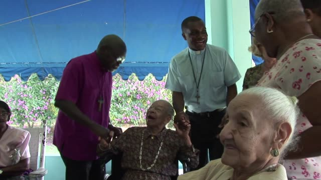as part of his visit to jamaica in 2012 the archbishop of york dr john sentamu visited a hone for the elderly dr john sentamu visits home for the... - emma brumpton stock videos & royalty-free footage