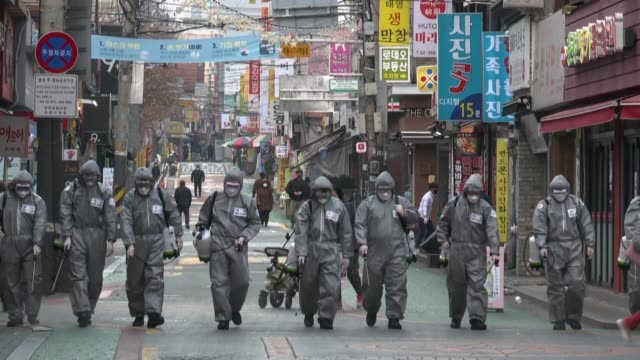as part of preventive measures to stop the spread of covid19 coronavirus the city government joins forces with the military to disinfect areas in... - corea del sud video stock e b–roll