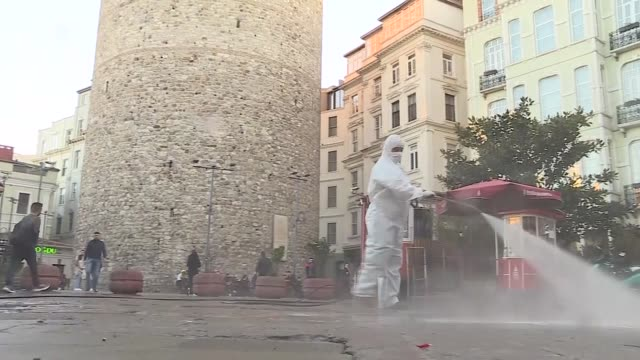as part of the ongoing precautionary measures against the spread of the novel coronavirus disinfection of galata tower and it's around continues on... - disinfection stock videos & royalty-free footage