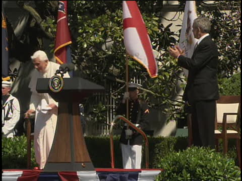 """as pope benedict xvi finishes a speech by saying """"god bless america,"""" president george w. bush walks up to him, shakes his hand, and says """"thank you... - blooper film clip stock videos & royalty-free footage"""