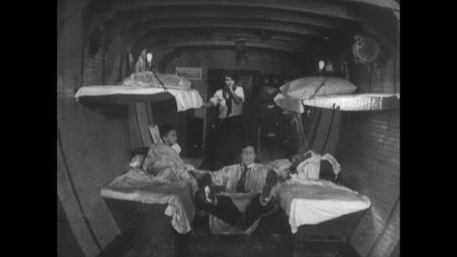1921 as sailing family gets ready for bed, nighttime storm causes problems - 1921年点の映像素材/bロール