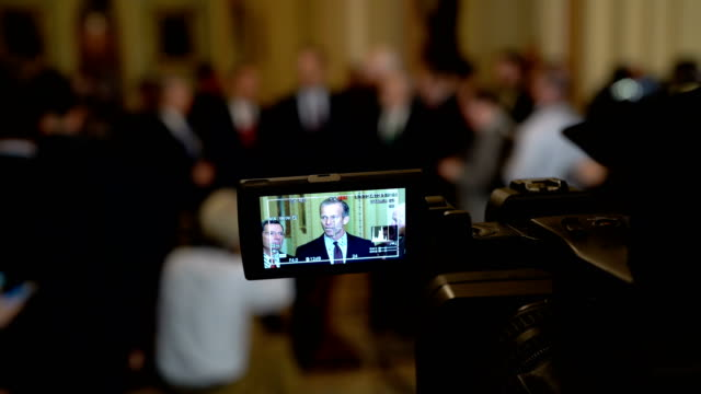 as seen on a video camera screen us sen john thune speaks to members of the media during a news briefing after a weekly senate republican policy... - usa:s senat bildbanksvideor och videomaterial från bakom kulisserna
