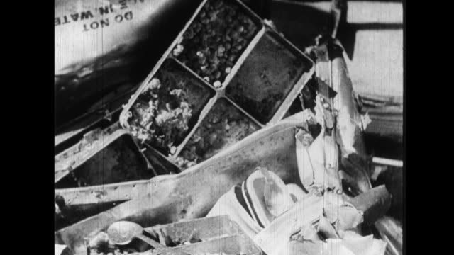 As soldiers inspect the wreckage of a downed B29 civilians and soldiers cope with bomb devastation with rubble clearance electrical restoration...
