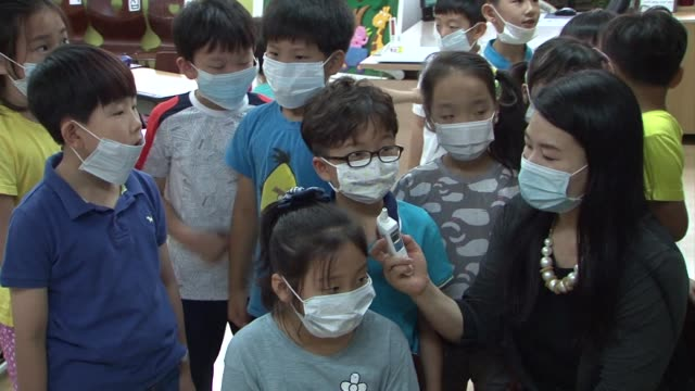 as south korea scrambles to control an outbreak of the killer mers virus its fearful citizens have donned surgical masks en masse but the jury is out... - protective mask workwear stock videos & royalty-free footage