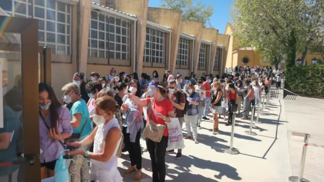 vídeos de stock e filmes b-roll de as spain will reopen schools next week in the capital madrid, teachers and non-academic personnel queued on september 02, 2020 to take a pcr... - person in education