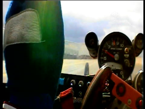 as starter lights change to begin race drag car rockets up track. - steering wheel stock videos & royalty-free footage