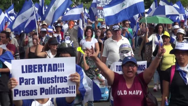 as supporters of the nicaraguan government march in managua thousands of anti government protesters also take to the streets demanding president... - managua stock videos & royalty-free footage